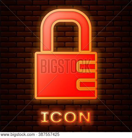 Glowing Neon Safe Combination Lock Icon Isolated On Brick Wall Background. Combination Padlock. Secu