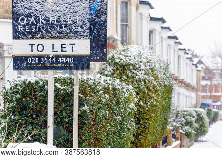 London, Uk - December 10, 2019 - To Let Sign Covered By Winter Snow Around West Hampstead Area With