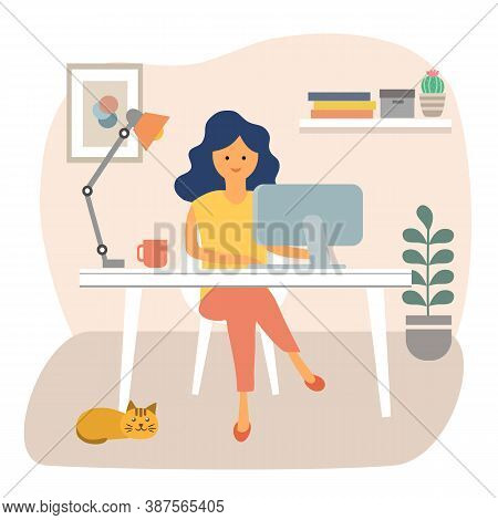 Cute Happy Woman Sitting At Desk And Working On Computer At Home. Female Freelancer Working At Workp
