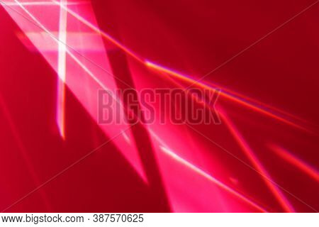 Blinding Sun Beams And Glimmering Rays On Red