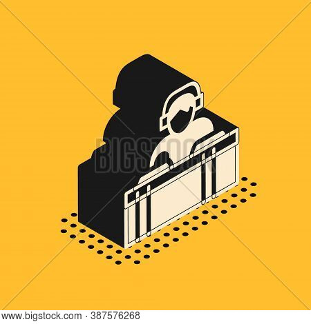 Isometric Dj Wearing Headphones In Front Of Record Decks Icon Isolated On Yellow Background. Dj Play