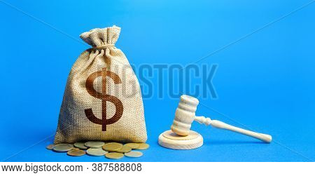 Dollar Money Bag And Judge's Gavel. Litigation, Dispute Resolution, Conflict Of Interest Settlement.