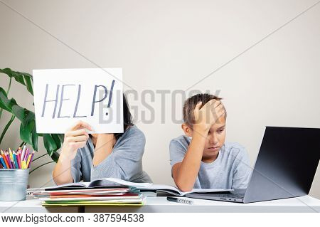 Learning Difficulties, Remote Education, Online Learning And Working At Home. Tired Mother And Sad K
