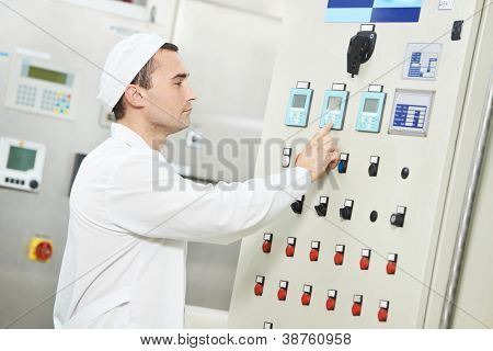 pharmaceutical factory man worker operating water preparation production line at pharmacy industry manufacture factory