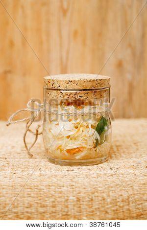 Sour cabbage - sauerkraut - in glass jar