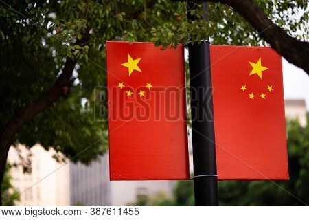 Huzhou, China 2020 September 28: Flags Of The Peoples Republic Of China On Street, Hanging In A Road