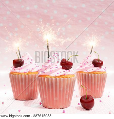 3d Illustration Of Thee Cherry Flavored Cupcakes With Swirling Icing Sugar Dressing And Festive Fire