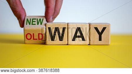 Businessman Turns A Cube And Changes Words 'old Way' To 'new Way'. Beautiful Yellow Table, White Bac