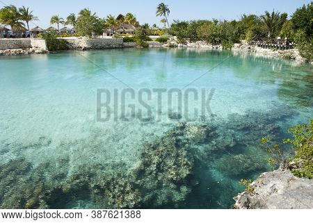 The View Of Colorful Fresh Water Lagoon Separated By The Tourist Beach From Caribbean Sea (cozumel,