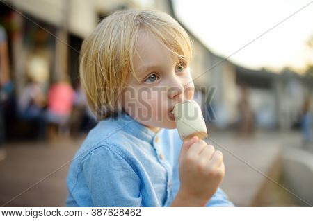 Little Boy Eating Tasty Ice Cream Outdoors During During Family Stroll. Gelato Is Loved Delicacy For