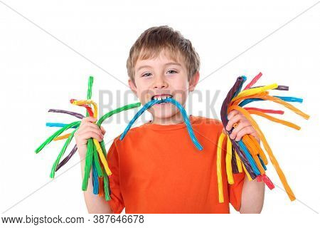 Smiling young boy holding colorful licorice candy