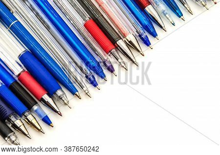 Lots Of Blue Ballpoint Pens, Multi-colored Ballpoint Pens On A White Background