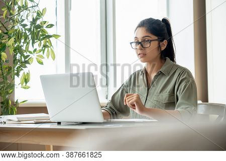 Indian Young Lady Teacher Or Student Watching Online Education Video Workshop Webinar, Distant Web S