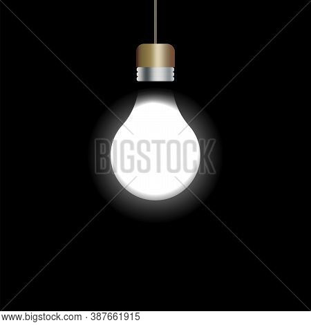 Light Bulb On A Black Background. Glowing Bulb. Bright Light From The Lamp. Vector Illustration.