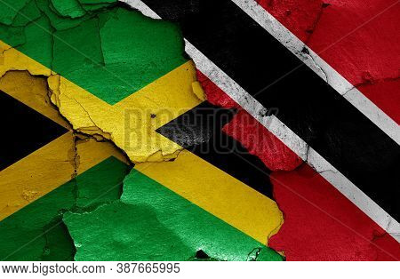 Flags Of Jamaica And Trinidad And Tobago Painted On Cracked Wall