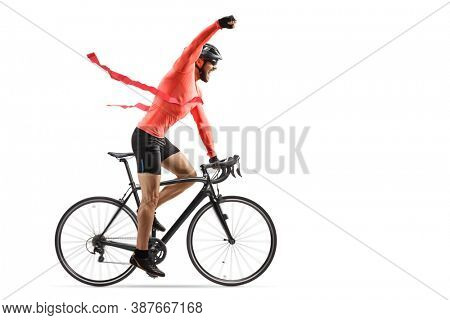 Male cyclist finishing a bicycle race at the finish line and gesturing win with hand isolated on white background