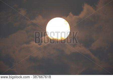 Beautiful Orange Sun On The Cloudy Sky