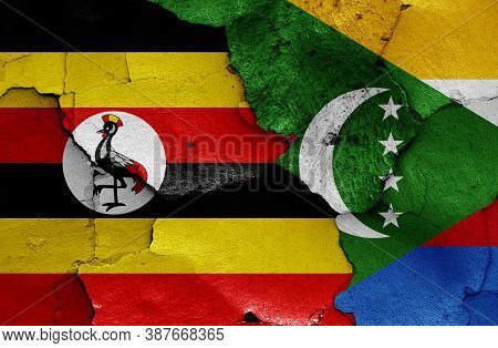 Flags Of Uganda And Comoros Painted On Cracked Wall