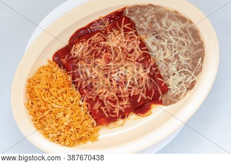 Overhead View Of Hearty Meal Of Traditional Enchiladas Tempts The Taste Buds To Eat The Entire Meal.
