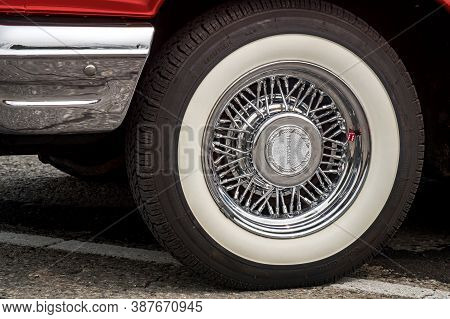 Toronto, Canada - 08 18 2018: Shiny Chrome True Classic Spoked Wheel Disk With Painted In White Coke
