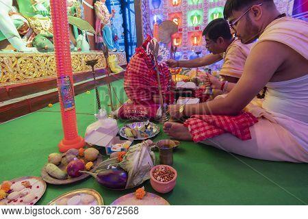 Howrah, West Bengal, India - 5th October 2019 : Hindu Bengali Priests Chanting Sanskrit Shlokas In D
