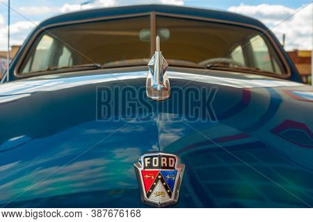 Williams, Usa - September 29 2015; Famous Ford Automobile  Badge On Blue Bonnet Of Vintage Car With