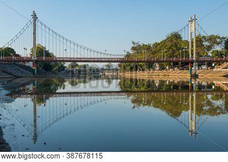 Beautiful Scenery View Of The Iconic Suspension Bridge (other Name Is Orange Bridge) Crossing Above