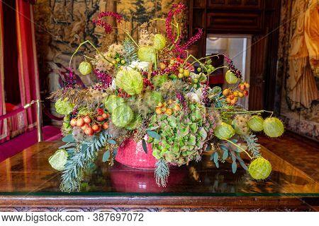 Beautiful Green Orange Flower Arrangement In Autumn Colors In A Castle Setting