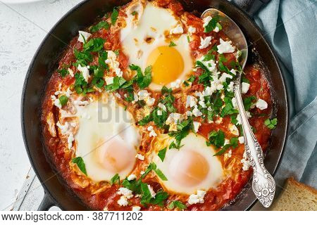 Shakshouka, Eggs Poached In Sauce Of Tomatoes, Olive Oil. Mediterranean Cousine.