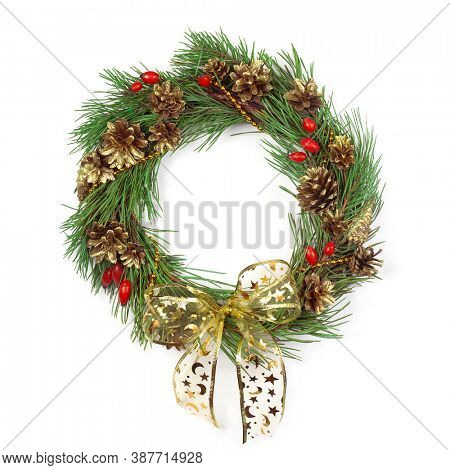 Christmas wreath with pine tree and gold cones on a white background