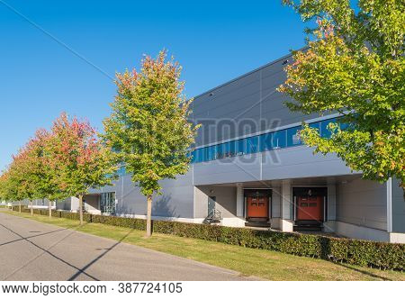 Large Warehouse With Loading Docks With Some Nice Trees In Front