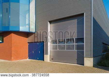Modern Industrial Unit With Grey Roller Door