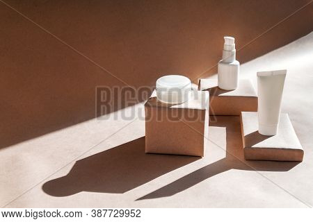 White Tube, Bottle, Jar Of Cream, Lotion, Gel On Podiums On Craft Background With Shadows. Cosmetics