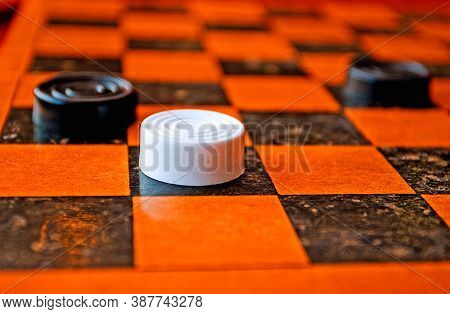 Game In Brazilian Checkers, White Checker Against Black