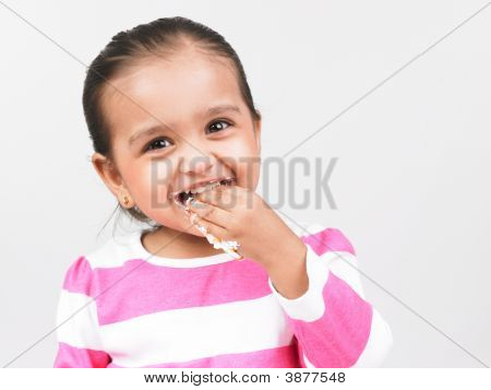 Asian Girl Of Indian Origin Enjoying Eating Her Cake