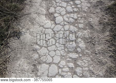 Texture Of Cracked Chalk Road. Background From Cretaceous  Road.