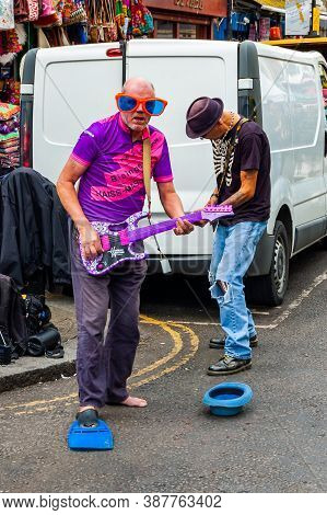 London, United Kingdom - September 16, 2017: Artists Performing Outdoors On The Street. Two Strange