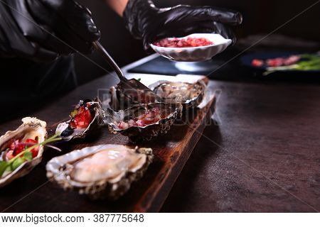 Spread The Red Onion And Olive Oil Sauce Over The Fresh Oysters. Oyster Season. Unrecognizable Photo