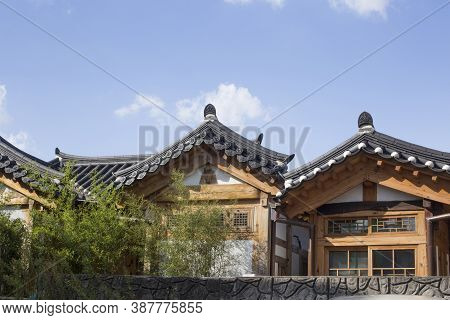 The Eaves Of Korean Traditional Houses On The Blue Sky Background.
