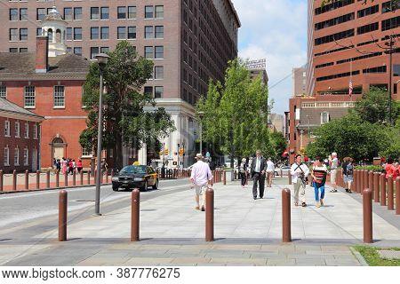 Philadelphia, Usa - June 11, 2013: People Walk In Philadelphia Historic District. As Of 2012 Philade