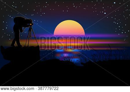 Photographer With Camera Silhouette On A Night Background. Photographer At Night Near Sea. Photograp