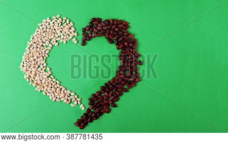 Shelled And Unshelled Pine Nuts Are Shaping A Heart. Concept Of Beneficial Effect Of The Nuts On Car