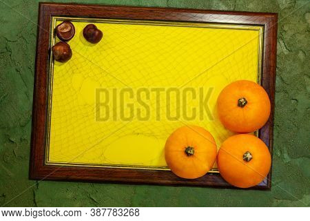 Frame With Yellow Paper Blank Space For Text With Pumpkins And Buckeye On The Green Background. List