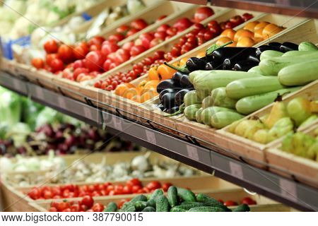 The Grocery Store Sells Various Vegetables, Tomatoes, Cucumbers, Eggplants, Peppers, Zucchini. Veget