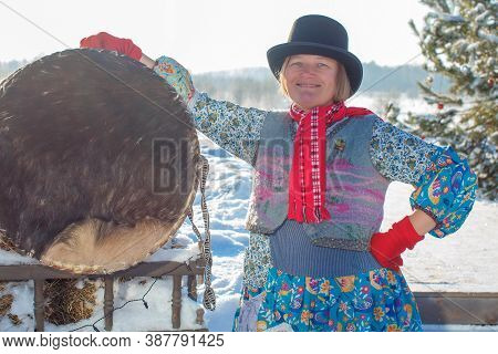 Female Shaman On Winter Nature With A Large Drum