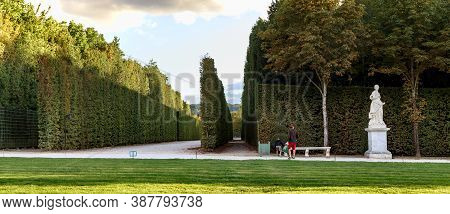 Versailles, France - September 8, 2019: These Are The Alleys Of The Versailles Palace Park In The Au