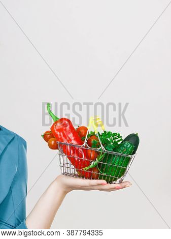 Lose Weight, Buying Healthy Food, Vegetarian Products. Woman Hand Holding Little Shopping Basket Wit