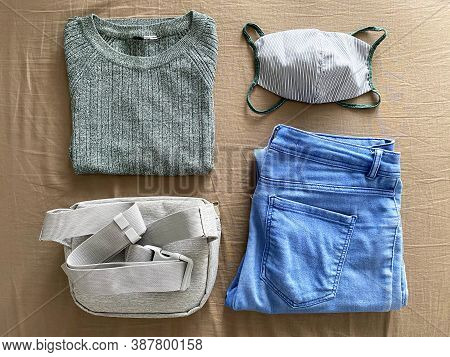 Matching Reusable Face Mask With Outfit. Green Sweater, Matching Cotton Face Mask, Blue Jeans And Gr