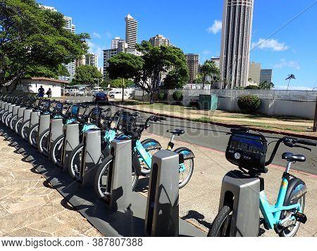 Honolulu - September 16, 2017: Row Of Biki Bikeshare In Ala Moana Beach Park.  Biki Is Honolulu's Ne