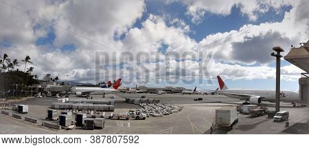 Honolulu - November 30, 2011: Hawaiian Airlines And Jal Planes Parked At Honolulu International Airp